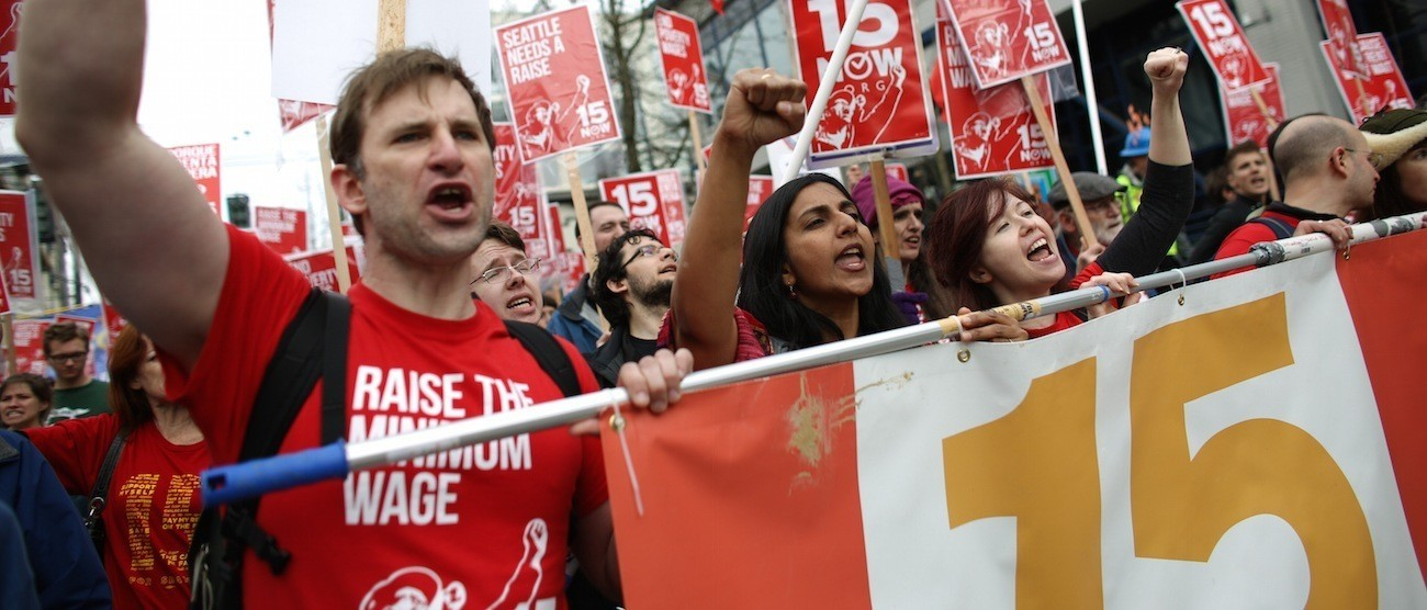 Bryan Watson, left, and Seattle City Councilmember Kshama Sawant at a March, 15, 2014 minimum wage march. (AP Photo/seattlepi.com, Joshua Trujillo)