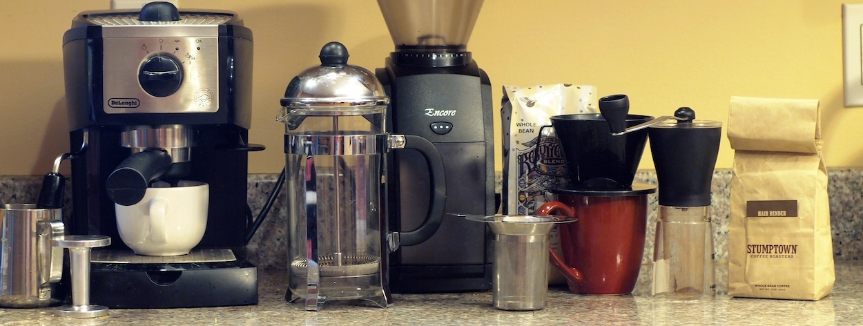 French press, espresso machine, grinder, whole coffee beans, mug, pour over